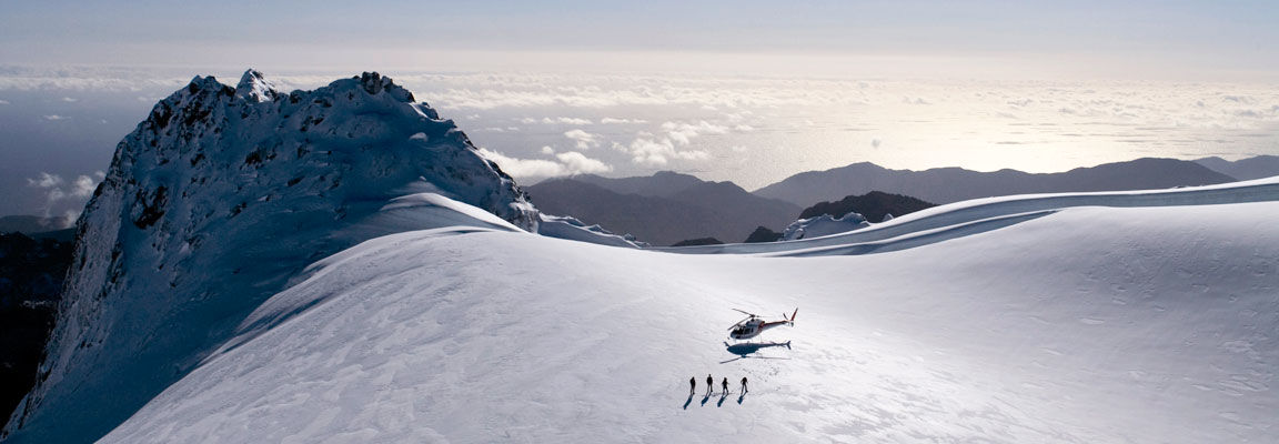 Visitors taking a scenic helicopter flight to the Darran Mountains, Fiordland