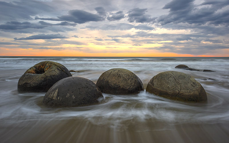 Marvel at the enchanting Moeraki Boulders