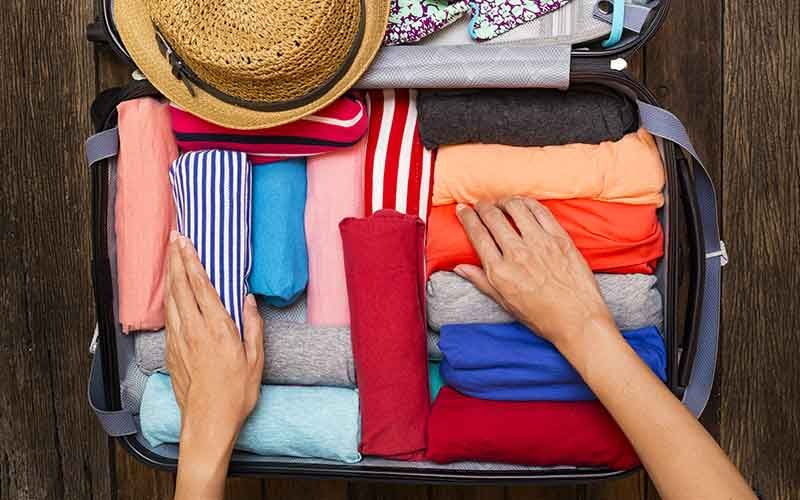 Roll clothing to pack your suitcase