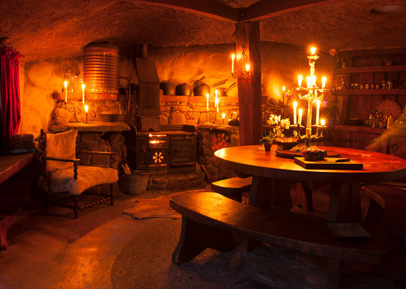 Relax by the fire at Underhill Valley Earth House