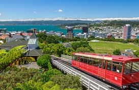 A red cable car overlooks the Wellington Central Business District