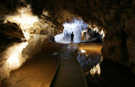 Visitor entering Waitomo caves on a guided tour
