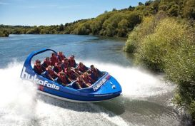 Visitors taking a thrilling jet boat road on the Huka River near Taupo