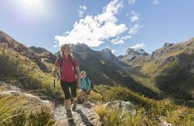 Hikers crossing a pass on the Routeburn Track Guided Walk