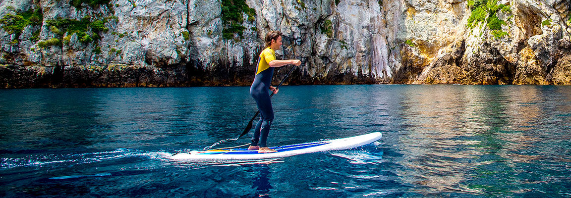 Paddle boarding near Poor nights Islands, New Zealand